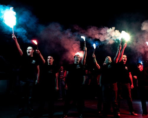 Members of far right group holding flares