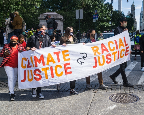 """Climate Justice in the Global North: An Introduction - Image: Protesters holding banner that reads """"Climate Justice, Racial Justice"""""""
