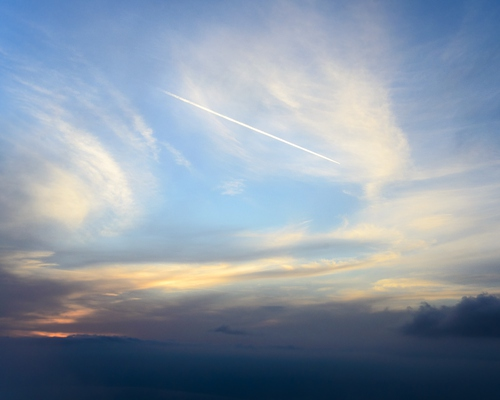 The politics and governance of research into solar geoengineering - image of whispy clouds