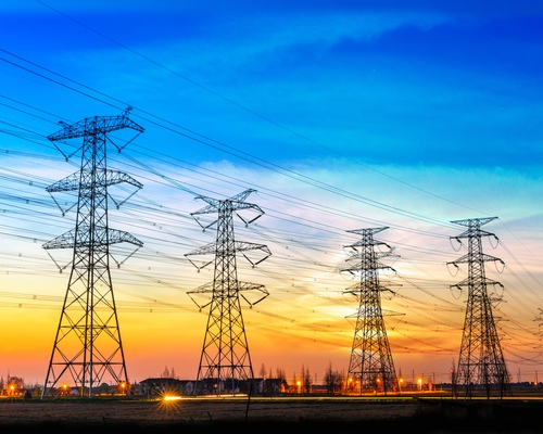 high voltage towers with sunset in background